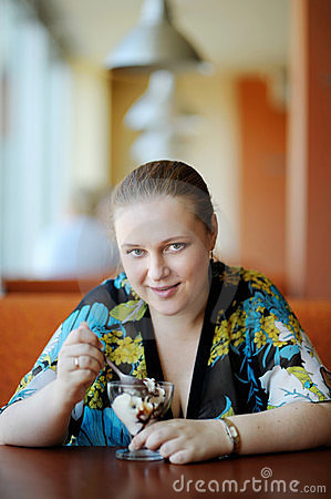 Young attractive woman in cafe