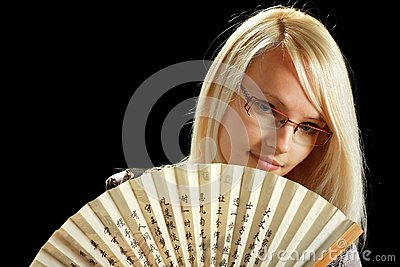 A young attractive woman with fan