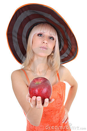 Young attractive woman in hat with red apple