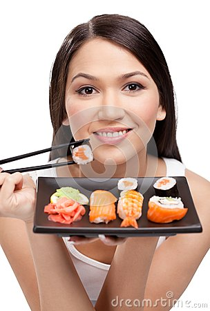 Young attractive woman holding sushi