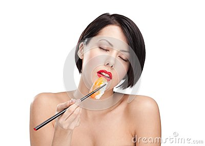 Young attractive woman holding sushi, eyes closed