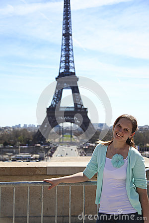 Young attractive woman near eiffel tower stock image image