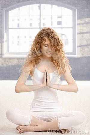 Young attractive woman practicing yoga prayer pose