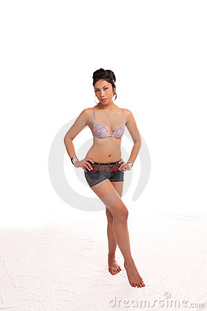 Young attractive woman in shorts and bra