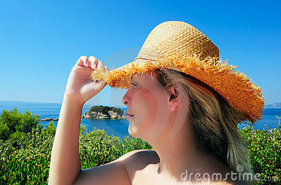 Young attractive woman in straw hat