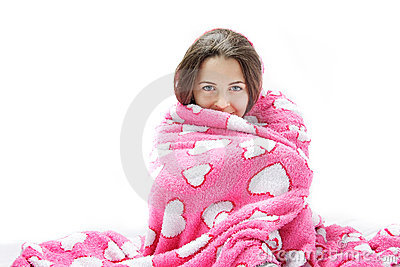 Young attractive woman wrapped in pink blanket