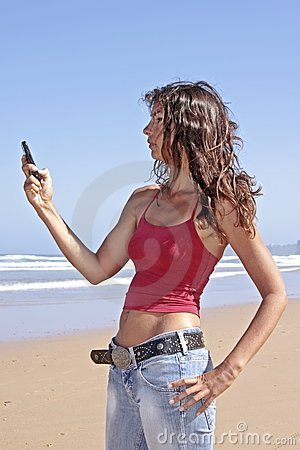 Young attractive woman writing a text message
