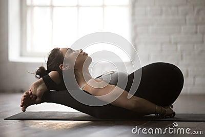 Yoga Nidrasana Yogic Sleep Pose Stock Photos, Images, & Pictures ...