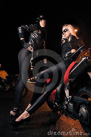 Young attractive women and motorcycle