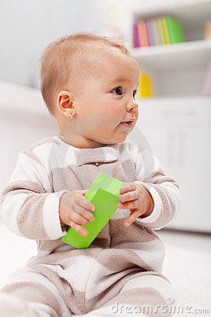 Young baby with block toy