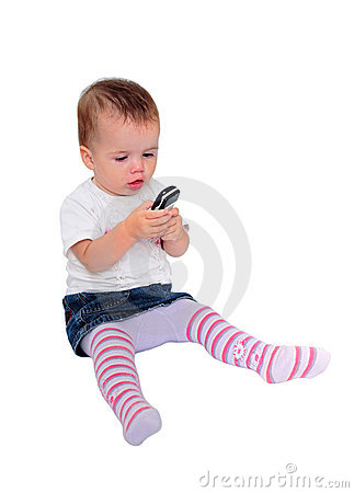 Young baby girl sending text messages on mobile phone