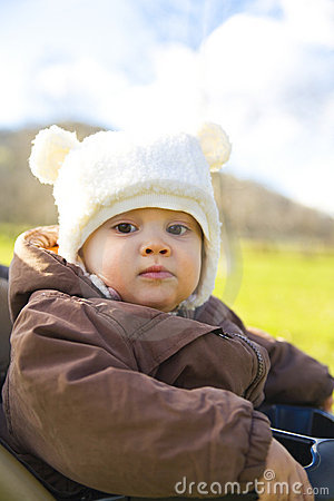Young baby in winter clothes