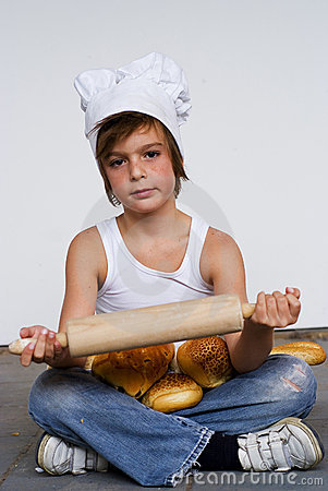 Young baker boy and bread