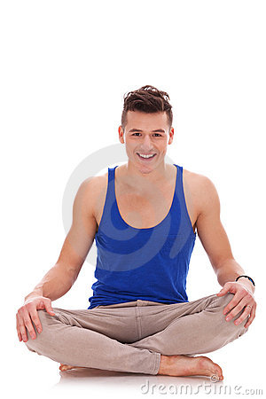 Young barefoot man in a yoga position