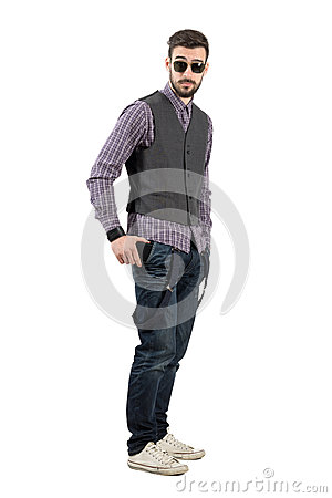 Free Young Bearded Man Putting His Mobile Phone In His Pocket Stock Photo - 54317480