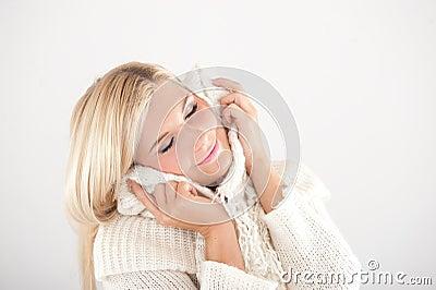 Young beautiful blond winter woman