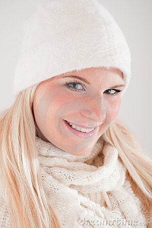Young beautiful blond winter woman