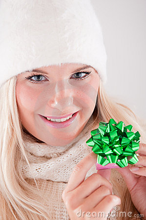 Young beautiful blond winter woman with gift