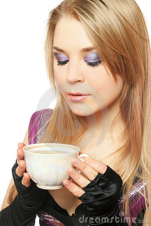 Young beautiful blonde with a cup