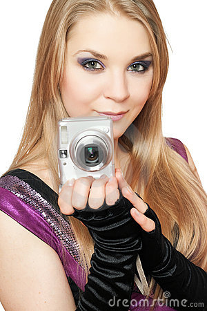 Young beautiful blonde holding a photo camera