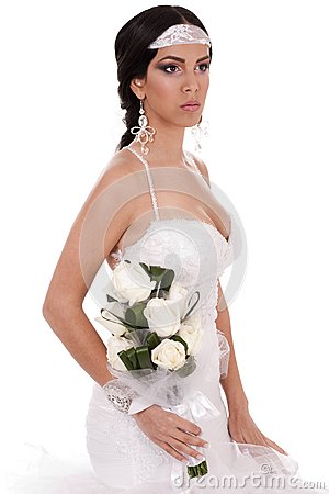 Young beautiful bride with bouquet of roses