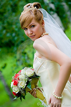 Young beautiful bride with flowers outdoor
