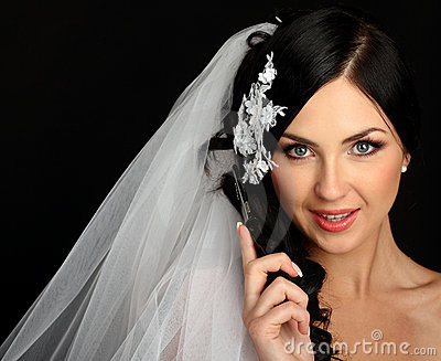 Young beautiful bride talking on mobile phone