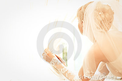 Young beautiful bride waits for groom