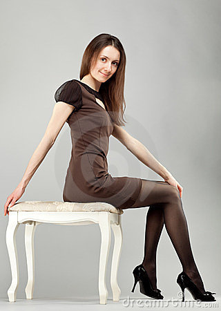 Young beautiful brunette girl in dress
