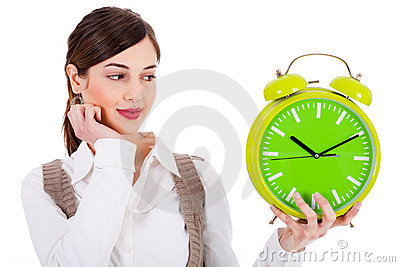 Young beautiful brunette holding the clock