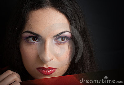 Young beautiful brunette woman closeup portrait