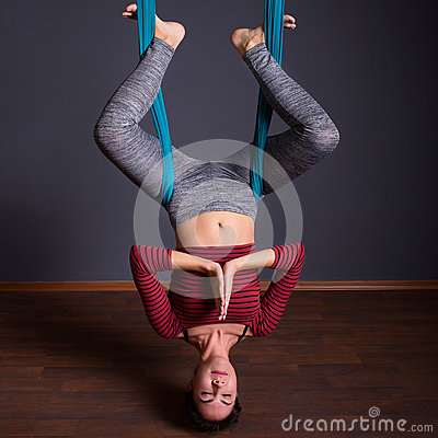 Free Young Beautiful Brunette Woman Doing Fly Yoga. Sitting In Hammock With Namaste Gesture. Wellness Concept. Stock Image - 90614371