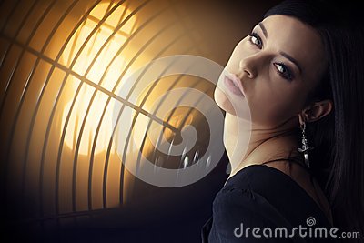 Young beautiful brunette woman portrait in floodlight