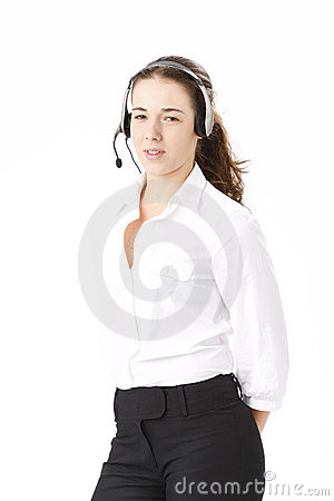 Young beautiful business woman using head phone