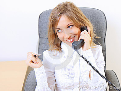 Young beautiful business woman working at office