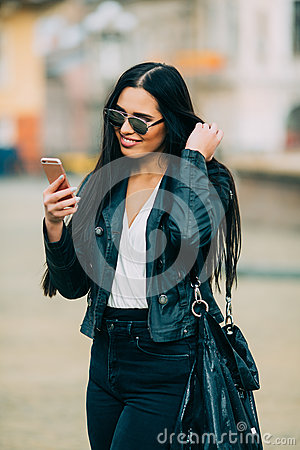 Free Young Beautiful Casual Girl Takes A Selfie On Her Cell Phone With Sunglasses Stock Photo - 66702200