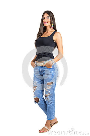 Free Young Beautiful Casual Woman In Torn Jeans Smiling At Camera With Hands In Pockets Royalty Free Stock Photos - 58972548