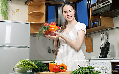 Young beautiful caucasian woman in the kitchen