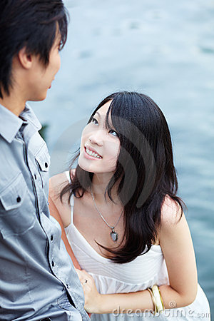 Young beautiful Chinese girl enjoys intimacy