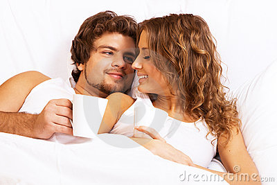 Young beautiful couple enjoying morning coffee