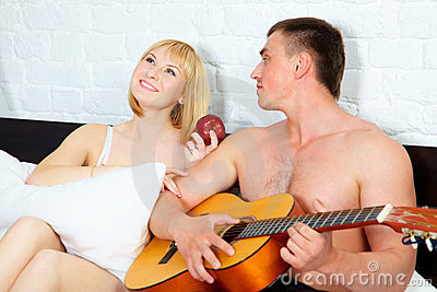 Young and beautiful couple with guitar