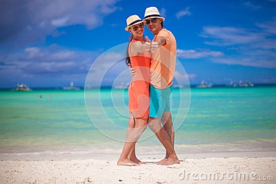 Young beautiful couple showing thumbs up on the