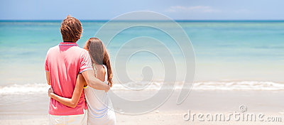 Young beautiful couple on tropical beach