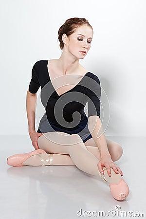 Young beautiful dancer posing on a studio