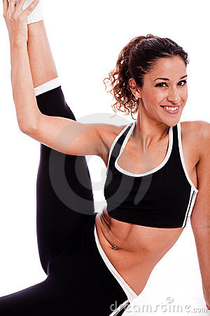 Young beautiful Fitness woman stretching her leg