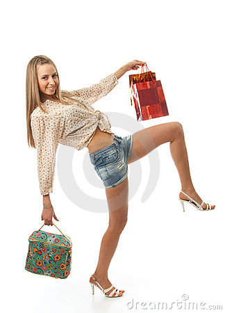 The young beautiful girl with a bags