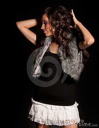 Young beautiful girl dancing on black background