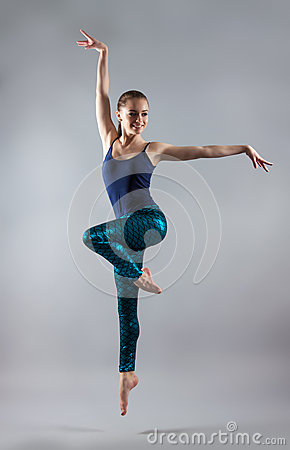 Free Young Beautiful Girl Dancing. Woman In A Blue T-shirt And Blue Tights. Royalty Free Stock Photos - 68249658