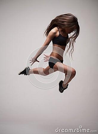 Girl doing gymnastick jump