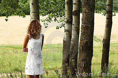 Young beautiful girl dreamy in nature